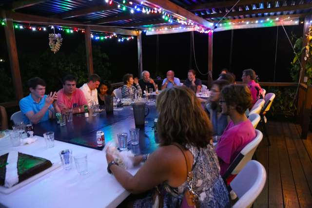 Group at Sol Food: The trip members share a relaxing evening around the table at Sol Food. The menu included salad, rice, veggies, pasta salad, and lionfish (of course).