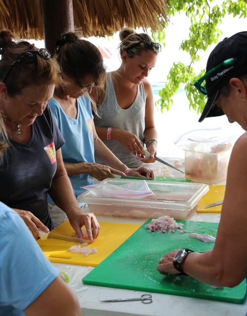 Dicing team: Trip participants spent hours dicing hundreds of fillets for the ceviche dinner. It is important to cut the fillet into small pieces so the lime juice can permeate the meat, curing it thoroughly. (Photo credit Jaclyn Gerakios)