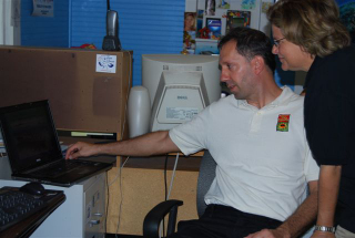 Joseph Cavanaugh demonstrates the new REEF website to the Congresswoman.