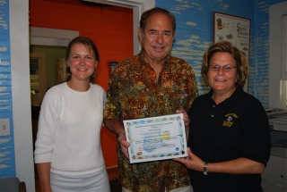 Leda Cunningham and Paul Humann present the Congresswoman with certificate of appreciation for her commitment to conservation.