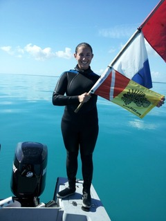 REEF Volunteer and Pennekamp Park Ranger Liz surveys lionfish sites in her new BARE wetsuit.