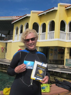 REEF member Martha surveys in Bonaire in her new and toasty BARE wetsuit.