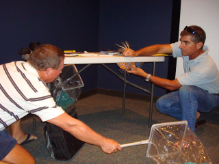 Lad Akins demonstrates safe collection technique of the venomous lionfish during a workshop in the Florida Keys.